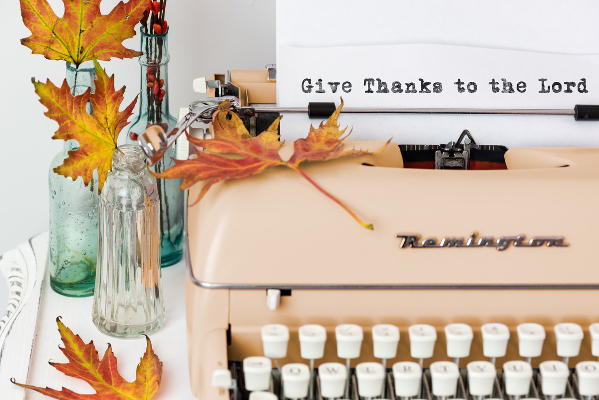 keyboard with leaves paper with typing Give thanks