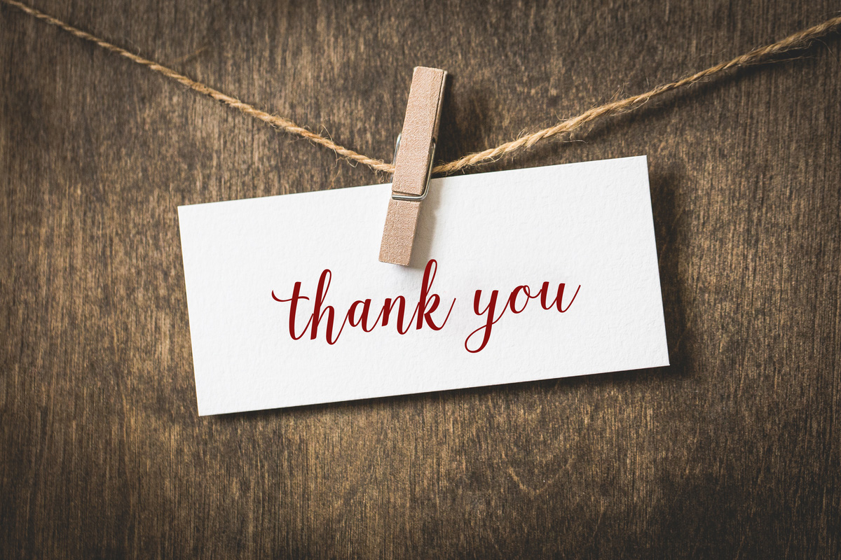 thank you note clipped to a string by a clothespin