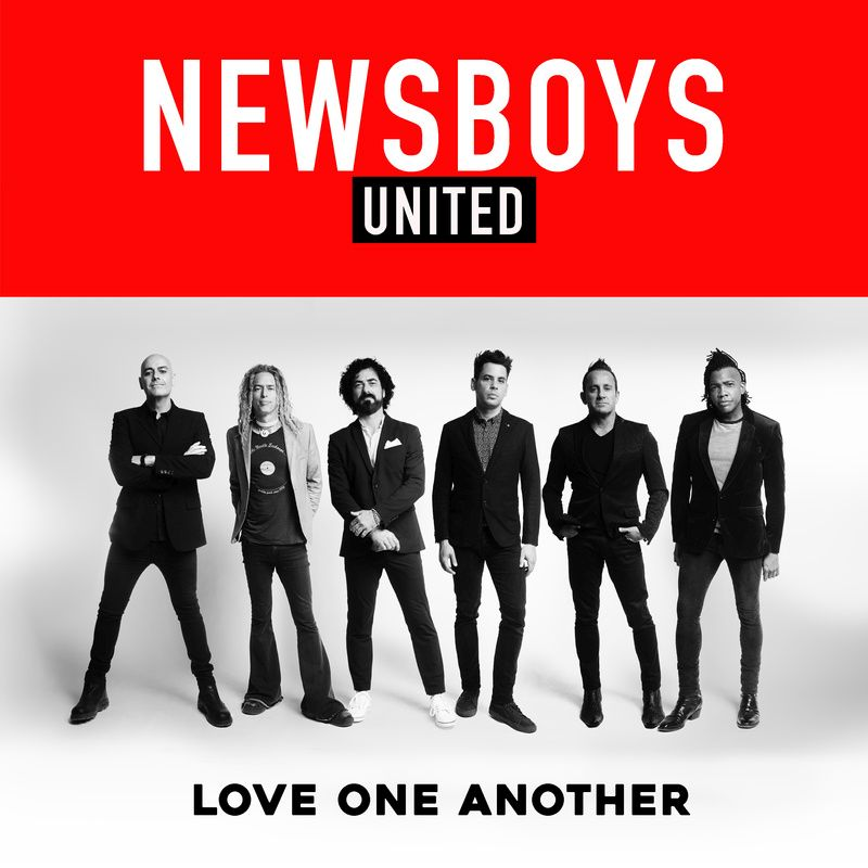 Newsboys United Album Cover the six members are standing together some with their hands in their pockets and some just looking chilled out the album cover says Love One Another on the bottom