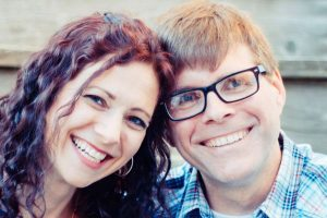 Joe Buchanan smiling with his wife, Tara